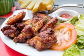 Chicken wings with sauce — Stock Photo
