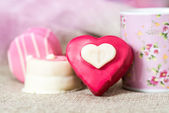 Small heart-shaped chocolates — Stock Photo