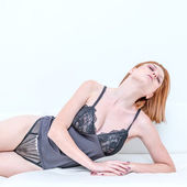 Beautiful young attractive caucasian woman in lingerie  — Stock Photo