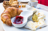 Coffee and croissants — Stock Photo