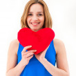Young woman holding a red heart — Stock Photo #48882857
