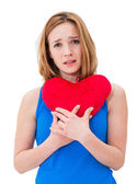 Lonely sad woman holding red valentine heart — Stock Photo