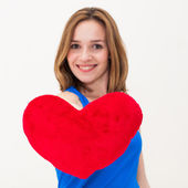 Young woman holding a red heart — Stock Photo