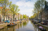 Amsterdam canals with bridge and typical dutch houses. — Stock Photo