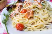 Pasta and smoked salmon with tomato — Stock Photo