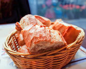 Little roll breads in basket on table — Stock Photo