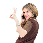 Portrait young woman talk on a cellular telephone — Stock Photo
