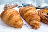 Coffee and croissants on table — Stock Photo