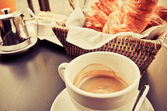 Coffee and croissants in a basket — Foto Stock