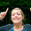 Woman with her finger up — Stock Photo #9389398