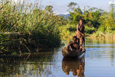 Malagasy children paddling — Stock Photo