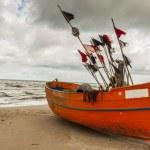 Orange fishing boast - Rewal, Poland. — Stock Photo