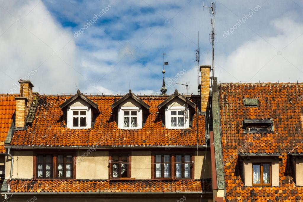 View on old building in Reszel, Poland. Tiled roofs and wooden windows. — Stock Photo #14730431