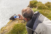 Photographer with digital camera - Latrabjarg Iceland — Stockfoto