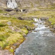 Rapid river in background Dynjandi waterfall - Iceland. — Stock Photo