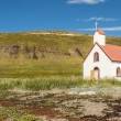 White wooden church in Unadsdalur Village - Iceland. — Stock Photo