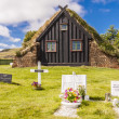 图库照片: View on graveyard and Vidimyri church - Iceland.
