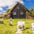 ストック写真: View on graveyard and Vidimyri church - Iceland.