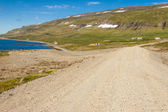 Rural gravel route to Unadsdalur village - Iceland. — Stockfoto
