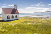 Wooden church on coast of Isafjardardjup fjord - Iceland. — Foto de Stock
