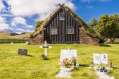 View on graveyard and Vidimyri church - Iceland. — Stock fotografie