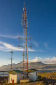 Telecommunications anetena on hill in Djupivogur village - Icela — Stock Photo