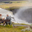 Royalty-Free Stock Photo: Two man on wooden bench - Iceland.