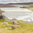 Gullfoss waterfall and two man on the wooden bench - Iceland. — Stock Photo #20185609