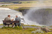 Two man on wooden bench - Iceland. — Stock Photo