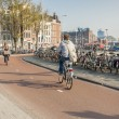 AMSTERDAM, NETHERLANDS - APRIL 22: go to work by bicycles — Stock Photo