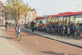 AMSTERDAM, NETHERLANDS - APRIL 22: go to work by bicycles — Стоковое фото