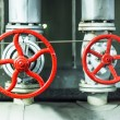 Red safety valves. — Stock Photo