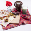 Plum cake and cup of milk on white. — Stock Photo