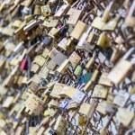 Love padlocks on Pont des Arts bridge, Seine river in Paris. Fra — Stock Photo