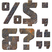 Old rusty metal english alphabet, numbers and signs — Stock Photo