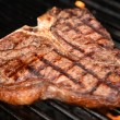 T-Bone Steak on the Grill — Stok fotoğraf