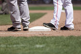 Players at First Base — Stock Photo