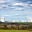 View of nuclear power plant and spring time village - life neat nuclear plant — Stock Photo #13632979
