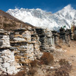 Stock Photo: Buddhist prayer walls or prayer stupas in nepal on the way to everest base camp
