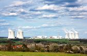 View of nuclear power plant and spring time village - life neat the nuclear plant — Stock Photo