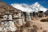 Buddhist prayer walls or prayer stupas in nepal on the way to everest base camp — Stock Photo