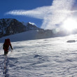 Group of climbers on rope on glacier - sunny day on mountain — Stock Photo #20585429