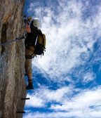 Alpinist on the via ferrata or klettersteig - extreme sport in Austria or Italy — Stock Photo