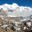 Hungchhi peak and Chumbu peak above Ngozumba glacier from Cho Oyu base camp - trek to Everest base camp - Nepal - Stock Photo
