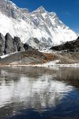 View of southern face of lhotse and nuptse mirroring on the lake on the way to everest base camp - nepal — Stock Photo