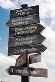 Tourist guidepost - dolomiti italy — Stock Photo