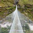 Rope hanging suspension bridge - Everest base camp trek in Nepal — Stock Photo