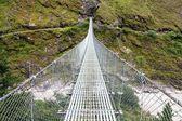 Rope hanging suspension bridge - Everest base camp trek in Nepal — Stock Photo