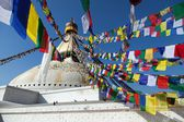 Boudnath stupa in Kathmandu with prayer flags - Nepal — Stok fotoğraf