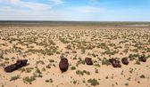 Boats in desert around Moynaq, Muynak or Moynoq - Aral sea or Aral lake - Uzbekistan - asia — Stock Photo